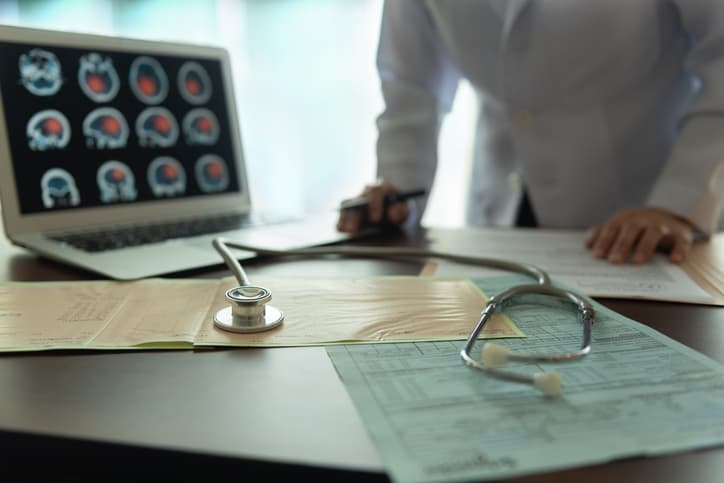 doctor looking at test results of the long term effects of a stroke